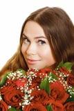 Mujer con las rosas Foto de archivo