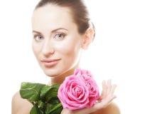 Mujer con las rosas rosadas Imagen de archivo
