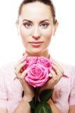 Mujer con las rosas rosadas Imagenes de archivo