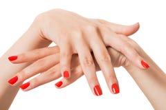 Mujer con las uñas rojas manicured hermosas Fotos de archivo libres de regalías