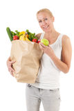 Mujer con las verduras y la fruta sanas Imagen de archivo