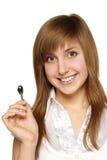 Mujer con llaves en casa Foto de archivo libre de regalías