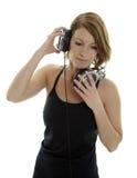 Mujer con los auriculares Fotografía de archivo libre de regalías