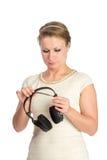 Mujer con los auriculares Fotografía de archivo