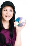 Mujer con los auriculares que sostienen el Cd Imagen de archivo