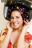 Mujer con los bigudíes Imágenes de archivo libres de regalías