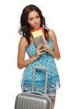 Mujer con los boletos y la maleta Fotos de archivo