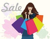 Mujer con los bolsos de compras stock de ilustración