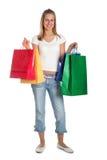 Mujer con los bolsos de compras Fotografía de archivo