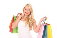 mujer con los bolsos para hacer compras Imagenes de archivo