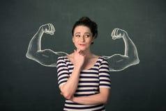 Mujer con los brazos fuertes y musculosos bosquejados Foto de archivo libre de regalías