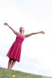 Mujer con los brazos levantados Imágenes de archivo libres de regalías