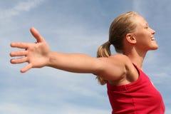 Mujer con los brazos outstretched Fotografía de archivo