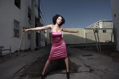 Mujer con los brazos outstretched Imagen de archivo libre de regalías