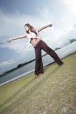 Mujer con los brazos outstretched Fotografía de archivo libre de regalías