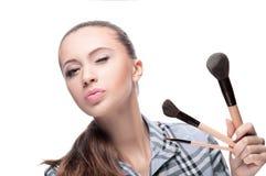 Mujer con los cepillos del maquillaje fotos de archivo libres de regalías