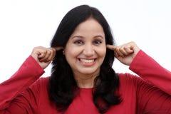 Mujer con los dedos en oídos Imagen de archivo libre de regalías