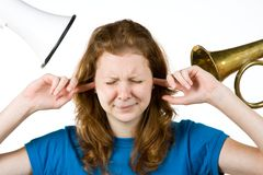 Mujer con los dedos en oídos Fotos de archivo libres de regalías