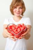 Mujer con los dulces rojos Fotografía de archivo