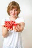 Mujer con los dulces rojos Foto de archivo libre de regalías