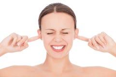 Mujer con los fingeres en oídos Imagen de archivo libre de regalías
