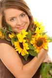 Mujer con los girasoles Imagen de archivo libre de regalías