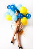 Mujer con los globos Foto de archivo libre de regalías