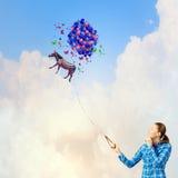Mujer con los globos Fotografía de archivo libre de regalías