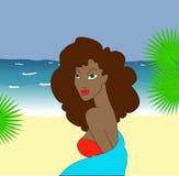 Mujer con los ojos verdes en la playa Fotografía de archivo libre de regalías