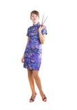 Mujer con los palillos Fotografía de archivo