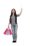 Mujer con los panieres aislados en blanco Foto de archivo libre de regalías