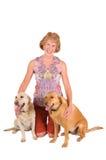 Mujer con los perros Foto de archivo libre de regalías