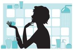 Mujer con los productos de belleza Fotos de archivo
