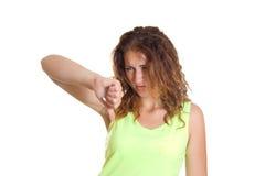 Mujer con los pulgares abajo Imagen de archivo libre de regalías