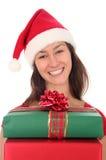 Mujer con los regalos de la Navidad Foto de archivo