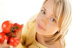 Mujer con los tomates Imagen de archivo