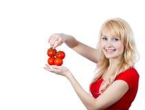 Mujer con los tomates Foto de archivo libre de regalías