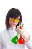 Mujer con los tubos químicos Foto de archivo libre de regalías