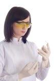 Mujer con los tubos químicos Imágenes de archivo libres de regalías