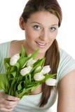 Mujer con los tulipanes Imágenes de archivo libres de regalías