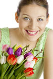 Mujer con los tulipanes Foto de archivo libre de regalías