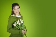 Mujer con los tulipanes Fotografía de archivo libre de regalías