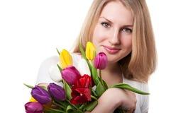 Mujer con los tulipanes Fotos de archivo