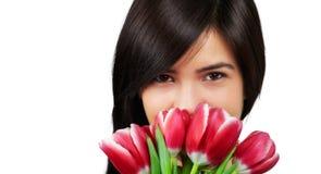 Mujer con los tulipanes Imagen de archivo
