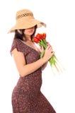Mujer con los tulipanes Imagenes de archivo