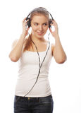 Mujer con música que escucha de los auriculares Aislador de la muchacha del adolescente de la música Foto de archivo