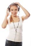 Mujer con música que escucha de los auriculares Aislador de la muchacha del adolescente de la música Fotos de archivo