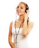 Mujer con música que escucha de los auriculares Aislador de la muchacha del adolescente de la música Fotografía de archivo libre de regalías