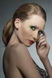 Mujer con maquillaje artístico foto de archivo
