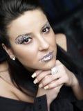 Mujer con maquillaje glittery fotografía de archivo libre de regalías